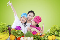 Children and their mom preparing vegetables Royalty Free Stock Images
