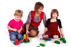Children and their mother building a castle Royalty Free Stock Photos