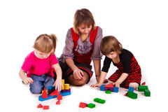 Children and their mother building with cubes royalty free stock photo