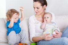 Children and their mother Stock Image