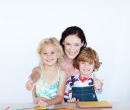 Children with their mother with thumbs up Stock Photography