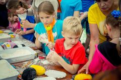 Children and their parents participating at anti-stress toy creation workshop. Zaporizhia/Ukraine- June 2, 2018: children and their parents participating at anti stock images