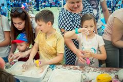 Children and their parents participating at anti-stress toy creation workshop. Zaporizhia/Ukraine- June 2, 2018: children and their parents participating at anti royalty free stock photo