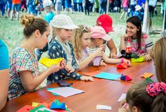 Children and their parents participating at origami workshop. Zaporizhia/Ukraine- June 2, 2018: children and their parents participating at origami workshop royalty free stock images