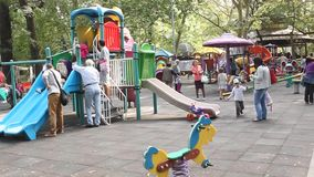 Children with their parents playing in the park stock footage