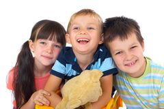 Children and their teddy bear Royalty Free Stock Photo