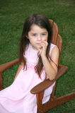 Children- Thinking Girl. Little girl with a serious look on her face Stock Photography