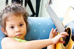 Children are thought to play a guitar or something Stock Photo