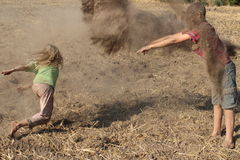 Children Throwing Dirt Royalty Free Stock Photography