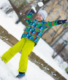 Children throwing snowballs Royalty Free Stock Photography