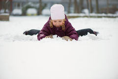 Children throwing snowballs Royalty Free Stock Photo