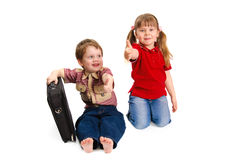 Children with thumbs up on a white Royalty Free Stock Images