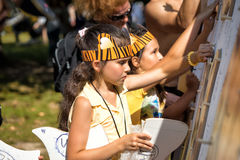 Children in tiger costumes draw Stock Images