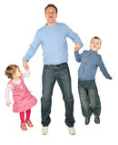 Children to keep for hands of father and jump. Royalty Free Stock Photo