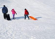 Children on a toboggan hill Stock Images