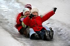 Children tobogganing Stock Photography