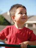 Children-Toddler Boy. Little boy looking up into the sky outside Stock Image