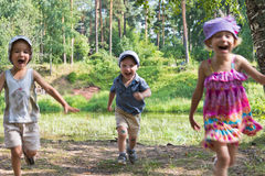 Children together in nature. Three children playing in nature stock photo