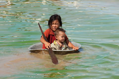 Children in the Tonle Sap lake in Cambodia Royalty Free Stock Photo