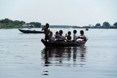 Children Traveling by boat in the Tonle Sap lake  Royalty Free Stock Images
