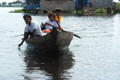 Children Traveling by Boat in the Tonle Sap lake  Stock Photo