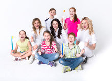Children with toothbrushes and doctors on white Stock Images