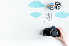 Children tourism outfit with toys and camera on white background flat lay mockup. Children tourism outfit with toys on white desk background flat lay mockup stock photos
