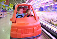 Children in toy automobile3 Royalty Free Stock Photography
