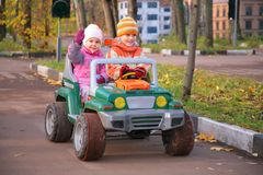 Children in toy car Stock Images