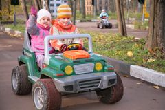 Children in toy car Royalty Free Stock Images
