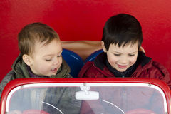 Children in toy car Stock Photos