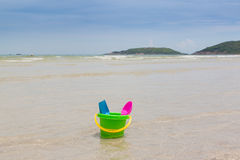 Children toy, colorful bucket and spoon on beach Royalty Free Stock Photo