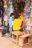 Children at Toy Stand in Banos, Ecuador Royalty Free Stock Photos