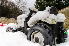Children toy tractor over the snow Royalty Free Stock Images