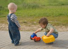 Children with a toy truck stock photography