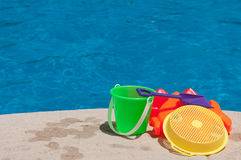 Children toys. Bright and colorful children toys at poolside (family vacations concept Royalty Free Stock Photography