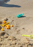 Children toys on the beach with clean blue water Stock Photography
