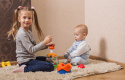 Children with toys. On floor Stock Photography