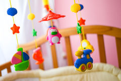 Children toys hanging from the crib Royalty Free Stock Photography
