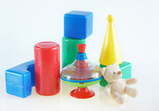 Children toys on light background Stock Photos