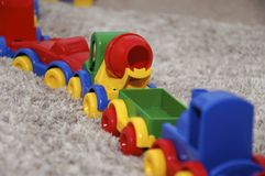 Children toys. Multi colored train is riding with wagons. Сonstructor Transport Stock Images
