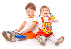 Children with toys in the studio. On a white background Stock Images