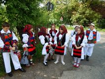 Children in traditional costumes from Maramures County, Romania stock photo