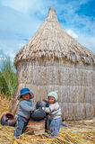 Children in traditional village on lake Titicaca in Peru Stock Photo