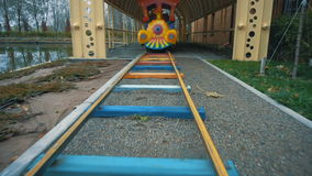 Children train at an amusement park in autumn. The movement from the first person stock video footage