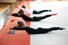 Children train back exercises in  gym Royalty Free Stock Images
