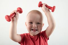 Children train with dumbbells. The concept of sport in the family.  Royalty Free Stock Images