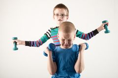 Children train with dumbbells. The concept of sport in the family.  Royalty Free Stock Photos