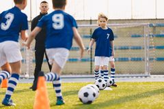 Children Training Football. Young Boys Running with Ball on Training Practice Session royalty free stock images