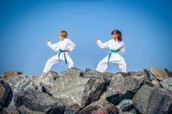 Children training karate on the stone coast Royalty Free Stock Photography